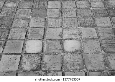 Earthenware tile floor as texture pattern background in black and white
