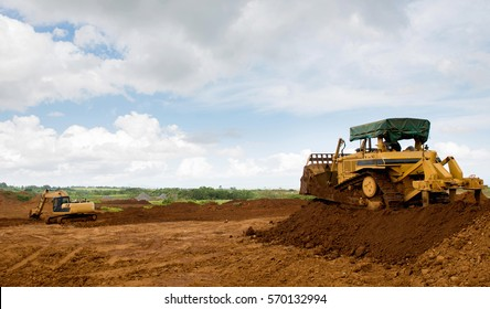 Earthmoving machine on duty. Bulldozer creating a trench.