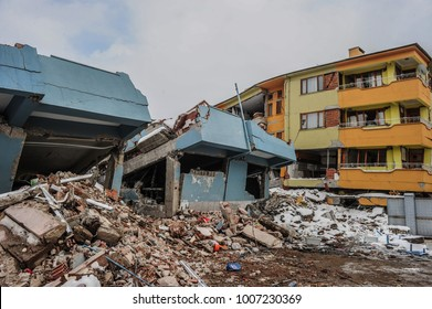 Earthquake and damaged building,