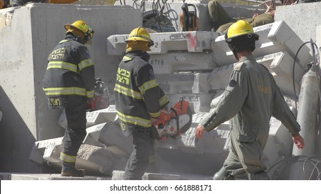Earthquake just happened, firefighters cut concrete damaged by earthquake rocket attack tsunami during Operation Turning Point 17 drill. Karmiel Israel, June 14th, 2017