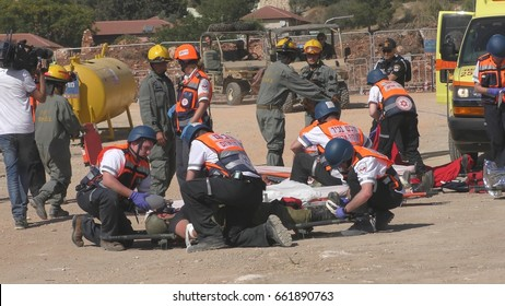 Earthquake just occurred. Homeland Security Soldiers paramedics and medical MDA staff deployed for rescuing injured people during Operation Turning Point 17 drill. Karmiel Israel, June 14th, 2017