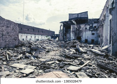 Earthquake or war aftermath or hurricane or other disaster, broken ruined buildings, pills of concrete garbage, dark toned