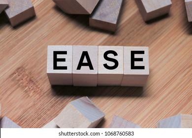 EASE Word Written In Wooden Cube