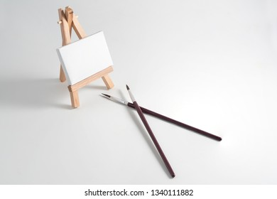 An easel with canvas and brushes