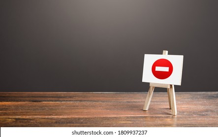 Easel with no entry symbol. Prohibition of actions and operations, restricted area. Ban and sanctions. Isolation zone and quarantine. Wrong direction. Failed strategy. Inaccessibility, taboo.