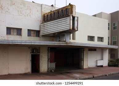 EAST BAKERSFIELD, CA - DECEMBER 8, 2018: The once-lovely old Grenada Theater has now degenerated into urban blight, the fate of many movie theaters that time has passed by.