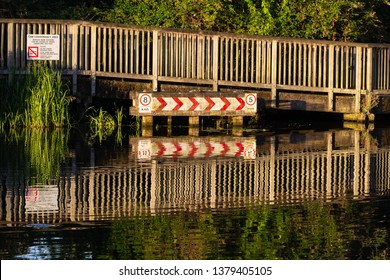 East Chesterton, Cambridgeshire/UK - August 10th 2015: Reflections in water of the River Cam along the walkway under the railway bridge.