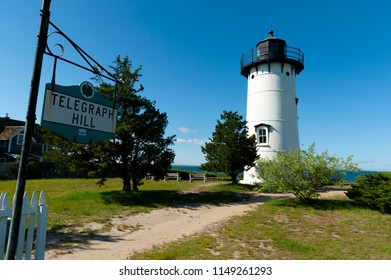 East Chop lighthouse sits atop famous Telegraph Hill overlooking the bay of Martha's Vineyard Island below.