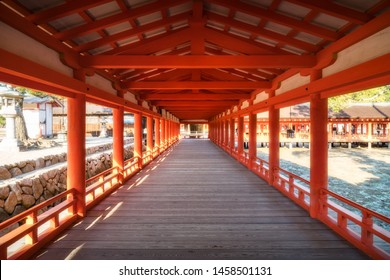 The East Corridor extends from the entrance of Itsukushima Shrine to Purification Hall. The historic temple is built on stilts in Shinden style of architecture -Miyajima Island, Japan.