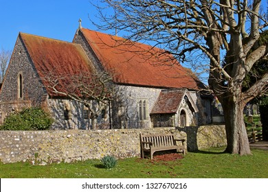 East Dean, East Sussex, England, U.K. - 02/20/2019. The Church of St Simon and St Jude is the parish church for this beautiful village in the South Downs, half a mile inland from the coast.
