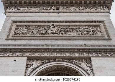 East facade of Arc de Triomphe. Arc de Triomphe de l'Etoile on Charles de Gaulle Place is one of the most famous monuments in Paris. France.