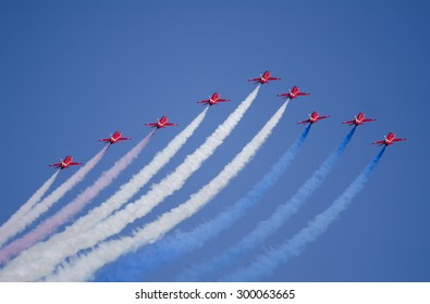EAST FORTUNE, UNITED KINGDOM - JULY 25: the RAF Red Arrows flight display team on July 25, 2015 above East Fortune, United Kingdom. 2015 marks the 50th year of Red Arrows flight displays.