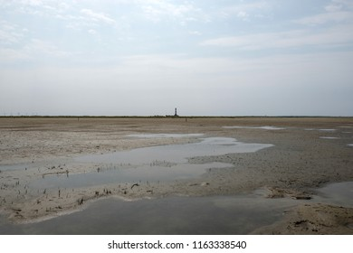 East Frisian landscape from the Wadden Sea with a view of a lighthouse