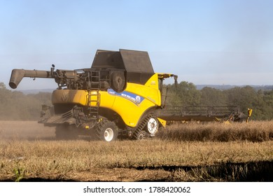 EAST GRINSTEAD, WEST SUSSEX/UK - JULY 30 : Harvesting rape seed on a farm near East Grinstead West Sussex on July 30, 2020. One unidentified person