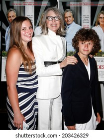 """EAST HAMPTON, NEW YORK-JULY 6: (L-R) Dexter Keaton, Diane Keaton and Duke Keaton attend the premiere of """"And So It Goes"""" at Guild Hall on July 6, 2014 in East Hampton, New York."""