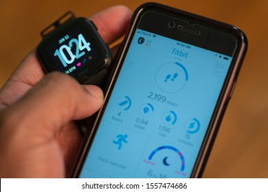 East Hartford, Connecticut, USA – November 3, 2019: close up of African American man wearing a Fitbit versa, Fitbit was recently acquired by Google's parent company Alphabet