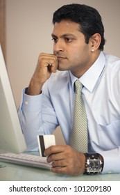East Indian businessman shopping online with credit card