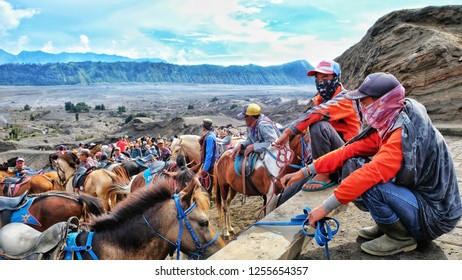 EAST JAVA, Indonesia - DECEMBER 12, 2018 : Horsemen on Mount Bromo volcano, Eastern Java, Indonesia,