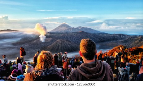 EAST JAVA, Indonesia - DECEMBER 12, 2018 : Tourists watching sunrise over Bromo volcano, Tengger Semeru National Park, East Java, Indonesia.