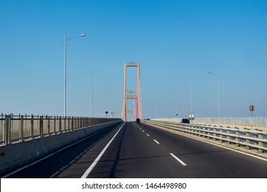 East Java - Indonesia. July 18, 2019:   Beautiful longest Suramadu bridge under blue sky in East Java, Indonesia