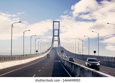 East Java - Indonesia. July 18, 2019:   Image of cars crossing on tollway of Suramadu bridge connecting island Surabaya and Madura in East Java, Indonesia