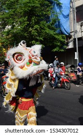 East java, Indonesia - July 2016: Barongsai and liang liong performance during yearly chinese festival on the street city act
