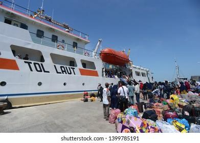 """East Java / Indonesia -  May 12, 2019: Residents ride the Sea Toll ship """"Sabuk Nusantara 92"""" at Kalianget Port, Sumenep, East Java."""