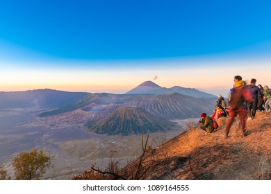 EAST JAVA, INDONESIA - SEPTEMBER 18, 2017: Tourists at viewpoint on Mount Penanjakan enjoying the view of Bromo volcano at sunrise, Tengger Semeru National Park, East Java, Indonesia
