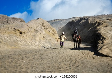EAST JAVA,INDONESIA-MAY 05 : Tourists ride the horse at Mount Bromo, The active volcano is one of the most visited tourist attractions on May 05,2013 in East Java, Indonesia.