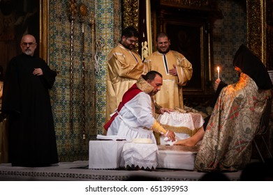 EAST JERUSALEM - APRIL 17: Armenian Patriarch of Jerusalem, Nourhan Manougian, washes the feet of fellow clergy during a Maundy Thursday mass in the Cathedral of St. James, Jerusalem, April 17, 2014.