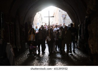 EAST JERUSALEM - APRIL 17: Palestinian Christians carry a cross from the Old City of Jerusalem to the Garden of Gethsemane on the Mount of Olives during a Maundy Thursday procession, April 17, 2014.