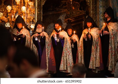 EAST JERUSALEM - APRIL 17: Priests hold candles during special Maundy Thursday mass in the Cathedral of St. James in the Old City of Jerusalem, April 17, 2014.