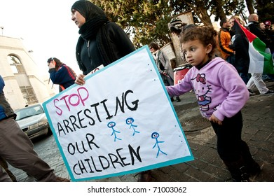 EAST JERUSALEM - FEBRUARY 11: An unidentified Palestinian mother and daughter protest Jewish settlements in the Sheikh Jarrah neighborhood of East Jerusalem on Feb. 11, 2011.