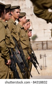 EAST JERUSALEM, OCCUPIED PALESTINIAN TERRITORIES - SEPTEMBER 4: Israeli soldiers stand in formation at the Western Wall in the Old City of Jerusalem on Sept 4, 2001.