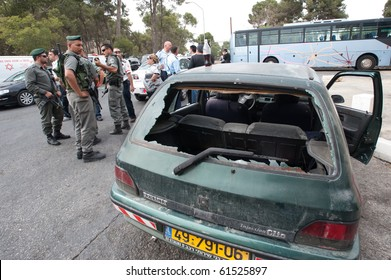 EAST JERUSALEM - SEPTEMBER 22: Police guard the scene after Israelis were attacked in their cars in reprisals after an Israeli security guard killed a Palestinian Jerusalem on September 22, 2010 in East Jerusalem