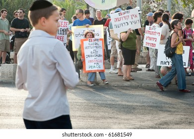 EAST JERUSALEM - SEPTEMBER 24: A Jewish boy watches as activists protest Israeli settlements in the East Jerusalem neighborhood of Sheikh Jarrah on Sept. 24, 2010 in East Jerusalem.