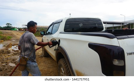 East Kalimantan / Indonesia: March 13, 2019: Filling of diesel oil for four-wheeled vehicles on oil palm plantations was sponsored by Pertamina's oil company.