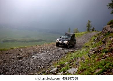 EAST KAZAKHSTAN REGION, KAZAKHSTAN - JULE 03, 2016: Suv on a road to the pass Burhat on Bukhtarma River valley, Altai mountain