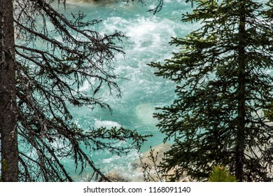East Kootenay/British Columbia/Canada - Jun 02 2018: Partial cascade view of the Vermilion River inside the Marble Canyon