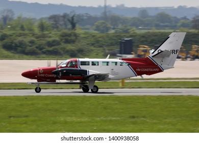 East Midlands Airport 16th May 2019. H M Coastguard Reims-Cessna F406 Caravan II (G-TURF) lands at the airport.