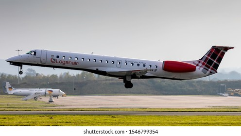 East Midlands Airport (EMA), England, 31th October 2019, Loganair passenger aircraft, G-SAJF an Embraer ERJ 135 lands at the airport.