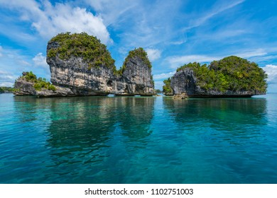 East Misool, group of small island in shallow blue lagoon water,