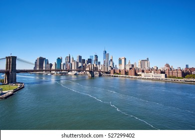 East River with the bridge connecting Brooklyn and Manhattan near the financial district skyline