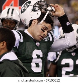 EAST RUTHERFORD - DECEMBER 12: New York Jets quarterback Mark Sanchez reacts after fumbling the ball to the Miami Dolphins at Meadowlands Stadium on December 12, 2010 in East Rutherford, NJ.