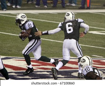 EAST RUTHERFORD - DECEMBER 12: New York Jets quarterback Mark Sanchez makes a play in a losing effort to the Miami Dolphins (10-6) at Meadowlands Stadium on December 12, 2010 in East Rutherford, NJ.