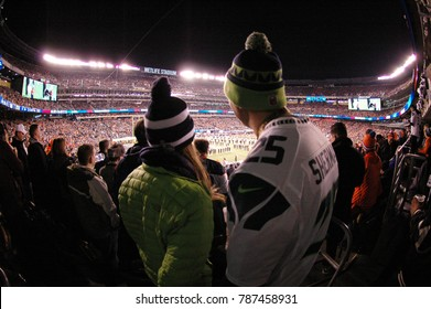 East Rutherford, New Jersey / USA - Feb. 2, 2014: Fans at Super Bowl XLVIII at MetLife Stadium in East Rutherford, New Jersey on Feb. 2, 2014. The Seattle Seahawks defeated the Denver Broncos 43 to 8.