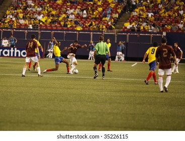 EAST RUTHERFORD NJ - AUGUST 12: Tomas Rincon #8 of Venezuela handles the ball against Colombia during the International Friendly match at Giants Stadium on August 12 2009 in East Rutherford NJ