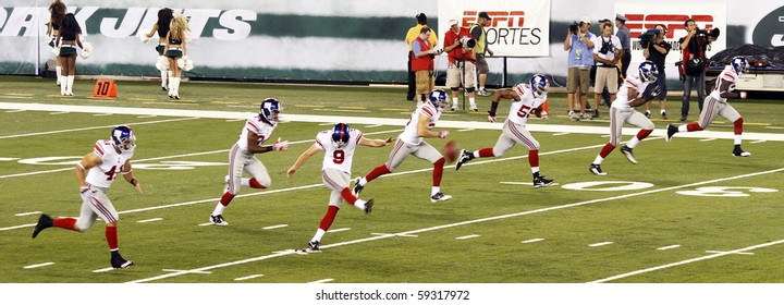 EAST RUTHERFORD, NJ - AUGUST 16: New York Giants kicker Lawrence Tynes leads the kickoff against the New York Jets at MetLife stadium on August 16, 2010 in East Rutherford, New Jersey.