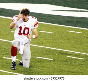 EAST RUTHERFORD, NJ - AUGUST 16: New York Giants quarterback Eli Manning receives a gash on forehead against the New York Jets at MetLife stadium on August 16, 2010 in East Rutherford, New Jersey.