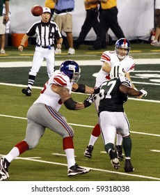 EAST RUTHERFORD, NJ - AUGUST 16: New York Giants Quarterback Eli Manning in action against the New York Jets at MetLife stadium on August 16, 2010 in East Rutherford, New Jersey.